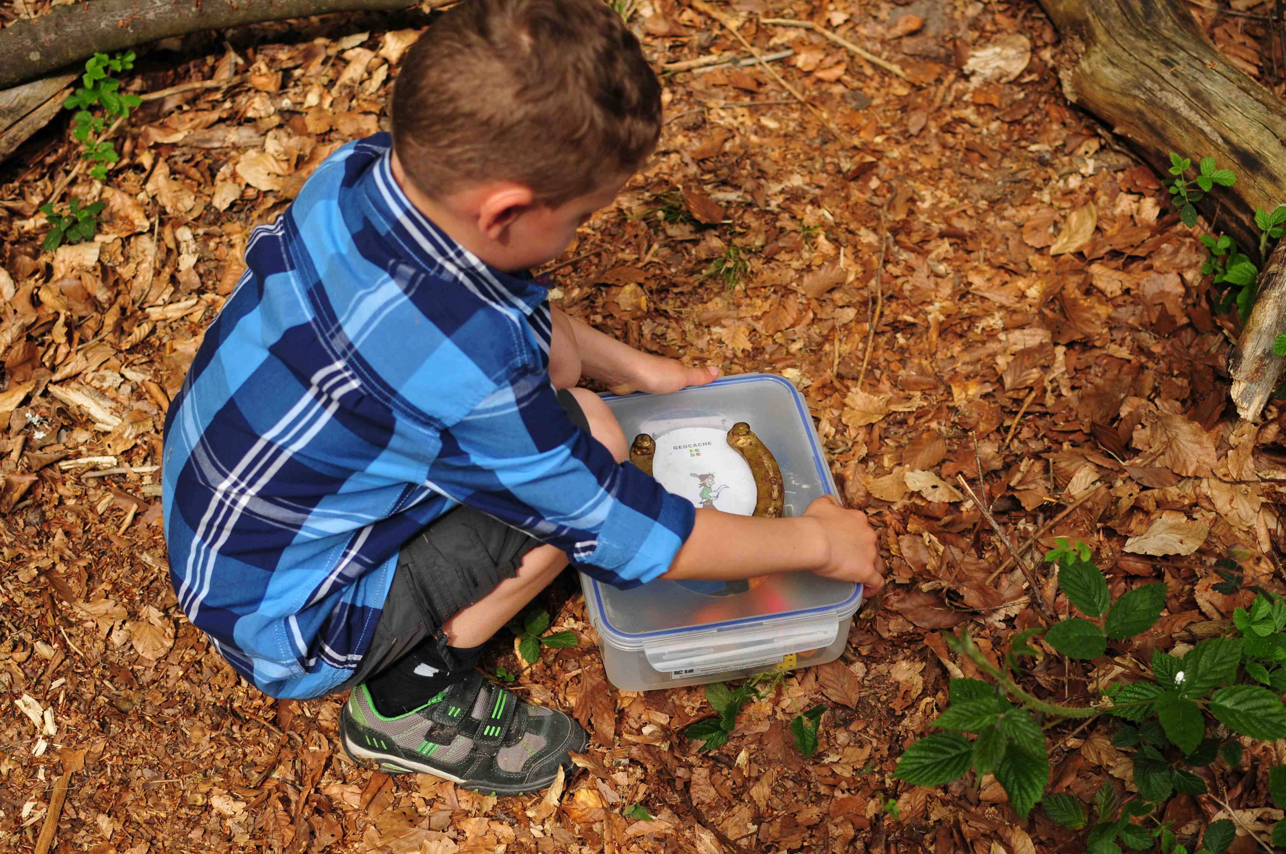 child with a geocache